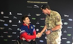 Maj. Gen. Neil Marshall, Senior British Military Advisor, U.S. Central Command receives a combat patch from U.S. Army Staff Sgt. (Ret.) Timothy Payne at this year's Invictus Games. The patch was worn by Payne on the day he was injured by an improvised explosive device in 2011 near Kandahar, Afghanistan.