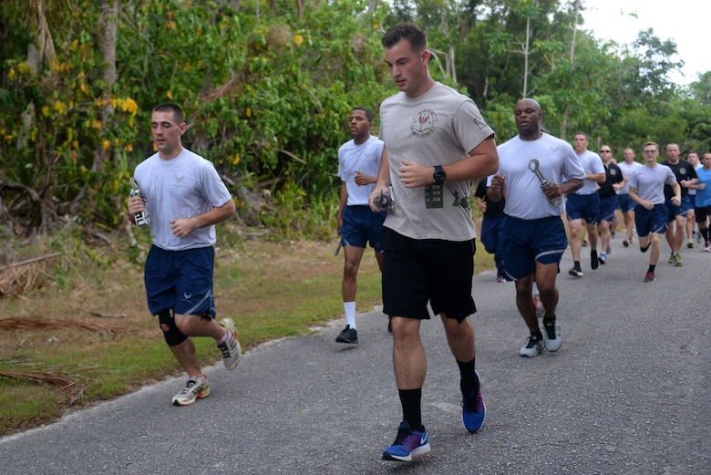 Air transportation specialists, commonly referred to as Port Dawgs, run with MB-1 devices during the Port Dawg memorial run May 20, 2016, at Andersen Air Force Base, Guam. The devices symbolize the five Port Dawgs who lost their lives in 2015. (U.S. Air Force photo by Airman 1st Class Alexa Ann Henderson)