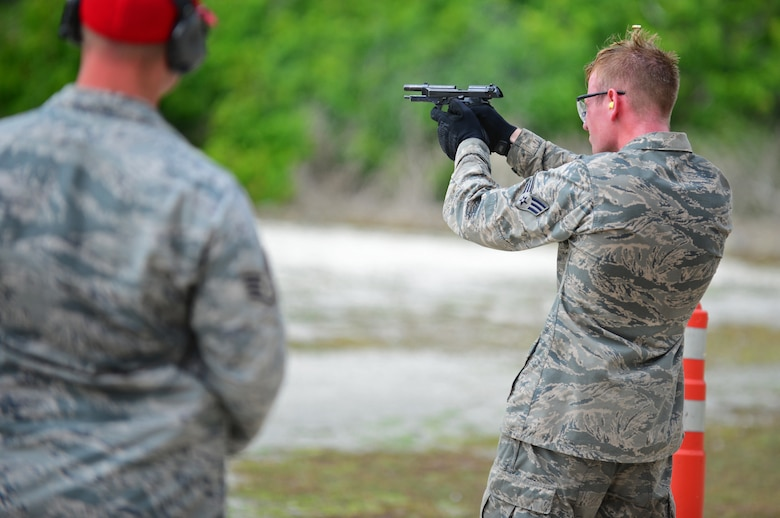 A Police Week Defender Challenge participant fires an M9 pistol May 18, 2016, at Andersen Air Force Base, Guam. To get people motivated for Police Week, the 36th SFS hosted the Defender Challenge, pitting Airmen against a variety of obstacles and navigational tasks. (U.S. Air Force photo by Senior Airman Joshua Smoot)