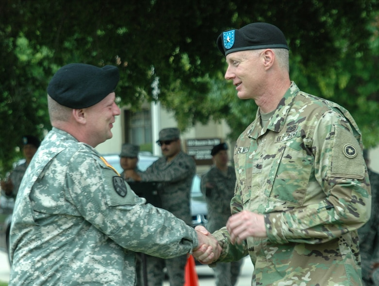 Brig. Gen. David Elwell, Commanding General, 311th Sustainment Command (Expeditionary), welcomes Col. Jon Blatt to his new command at the 304th Sustainment Brigade, March Air Reserve Base, Riverside, Calif., May 15, 2016. (Photo courtesy of Staff Sgt. Ailid Beckstrom, 304th SB)