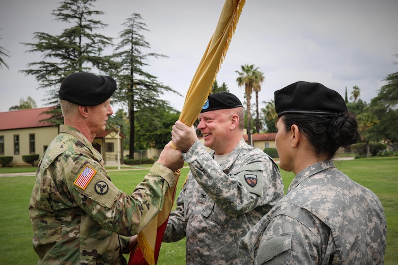 Brig. Gen. David Elwell, Commanding General, 311th Sustainment Command (Expeditionary), passes the colors to Col. Jon Blatt during the 304th Sustainment Brigade's Change of Command Ceremony, March Air Reserve Base, Riverside, Calif., May 15, 2016. (Photo courtesy of Staff Sgt. Ailid Beckstrom, 304th SB)