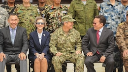 U.S. Pacific Command Commander, Admiral Harry Harris speaks with the President of Mongolia, The Honorable Tsakhiagiin Elbegdorj during the Khan Quest 2016 opening ceremony at Five Hills Training Area, Ulaanbaatar, Mongolia, May 22. Khan Quest 2016 is an annual multinational peacekeeping operations exercise conducted in Mongolia and is the capstone exercise for this year's Global Peace Operations Initiative program.