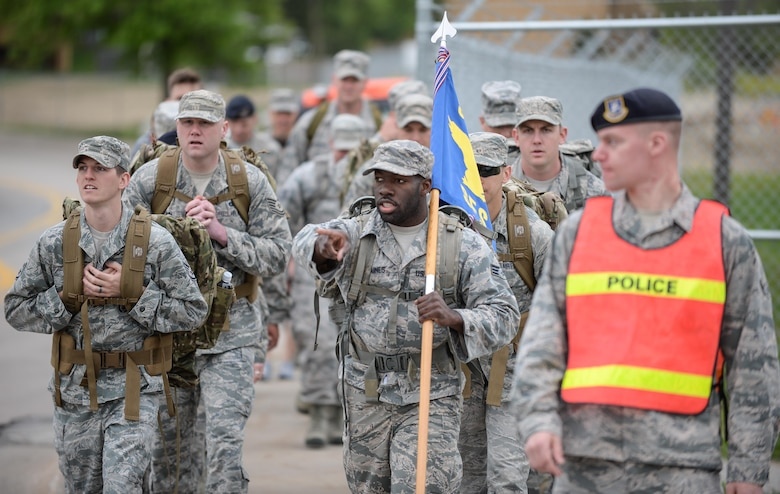 Airmen assigned to the 55th Security Forces Squadron prepare for a ruck march at Offutt Air Force Base, Neb., May 16, 2016 as part of the opening ceremony for National Police Week. Police Week in an annual celebration and time to honor law enforcement officials and agencies throughout the nation. (U.S. Air Force photo by Zachary Hada)