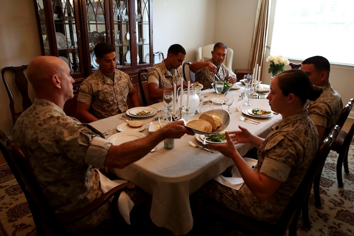 Meritoriously promoted sergeants from 1st Marine Logistics Group discuss leadership and the new role they will have as sergeants of Marines during a lunch hosted for them by the commanding general aboard Camp Pendleton, Calif., May 17, 2016. During the gathering the Marines had an opportunity to speak with their most senior leaders, to include the MLG commanding general, sergeant major, and command master chief. The four Marines promoted were Sgt. Olivia Berry, a combat engineer with Combat Logistics Battalion 5, Sgt. Lucas Ferreira, a combat engineer with 7th Engineer Support Battalion, Sgt. Jose Gaytan, an engineer equipment mechanic from Combat Logistics Battalion 11, and Sgt. Hector RiveraGuzman, a warehouse clerk with 1st Supply Battalion. (U.S. Marine Corps photo by Sgt. Carson Gramley/released)