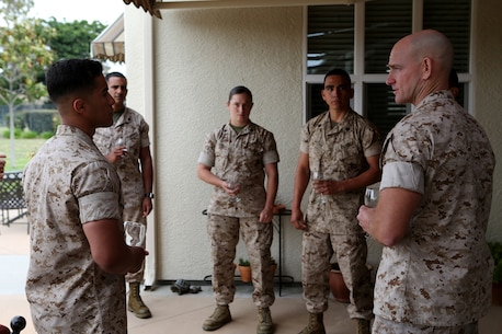 U.S. Marine Sgt. Maj. Troy E. Black speaks with meritoriously promoted sergeants from 1st Marine Logistics Group about leadership and the new role they will have as sergeants of Marines during a lunch hosted for them by the commanding general aboard Camp Pendleton, Calif., May 17, 2016. Black is the sergeant major of 1st MLG. During the gathering the Marines had an opportunity to speak with their most senior leaders, to include the MLG commanding general, sergeant major, and command master chief. The four Marines promoted were Sgt. Olivia Berry, a combat engineer with Combat Logistics Battalion 5, Sgt. Lucas Ferreira, a combat engineer with 7th Engineer Support Battalion, Sgt. Jose Gaytan, an engineer equipment mechanic from Combat Logistics Battalion 11, and Sgt. Hector RiveraGuzman, a warehouse clerk with 1st Supply Battalion. (U.S. Marine Corps photo by Sgt. Carson Gramley/released)