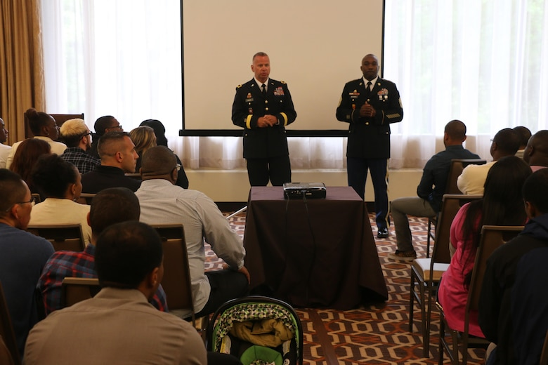 Army Reserve Brig. Gen. Vincent B. Barker, commanding general of the 310th Sustainment Command (Expeditionary) (left), and Command Sgt. Maj. Levi G. Maynard, senior enlisted advisor of the 310th Sustainment Command (Expeditionary) (right), speak to the Soldiers and Family members of the 313th Movement Control Battalion, headquartered in Baltimore, Md., during the yellow ribbon reintegration program event at the Tyson's Corner, Va. Sheraton Hotel, May 6-8, 2016. The event came prior to deployment of the Army Reserve Soldiers of the 313th Movement Control Battalion, and was designed to prepare airmen and their spouses for stresses and possible needs that can arise during a deployment.