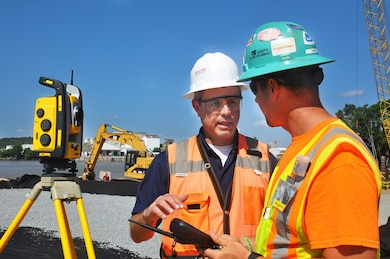 Pete Rapp of Sitech Mid-Atlantic, explains the operation of a locating and positioning device to Will Patterson of TIC, during the installation of a coffer dam along the Savannah River. Sitich supplied the equipment to TIC, a subcontractor on the dissolved oxygen injection system as part of the environmental mitigation for the Savannah Harbor Expansion Project (SHEP). The coffer dam will allow workers from CDM Constructors, the prime contractor for the dissolved oxygen injection system installation, to build the site for a series of Speece cones. These cones will super-oxygenate river water and inject it back into the Savannah River to maintain current levels of dissolved oxygen as the shipping channel is deepened. The U.S. Army Corps of Engineers, Savannah District, oversees the SHEP, including environmental mitigation.