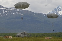 Paratroopers prepare to conduct parachute landing falls at Malemute drop zone during joint airborne and air transportability training at Joint Base Elmendorf-Richardson, Alaska, May 19, 2016. Air Force photo by Alejandro Pena