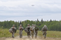 Paratroopers proceed to a rally and collection point after participating in joint airborne and air transportability training at Malemute drop zone at Joint Base Elmendorf-Richardson, Alaska, May 19, 2016. Air Force photo by Alejandro Pena