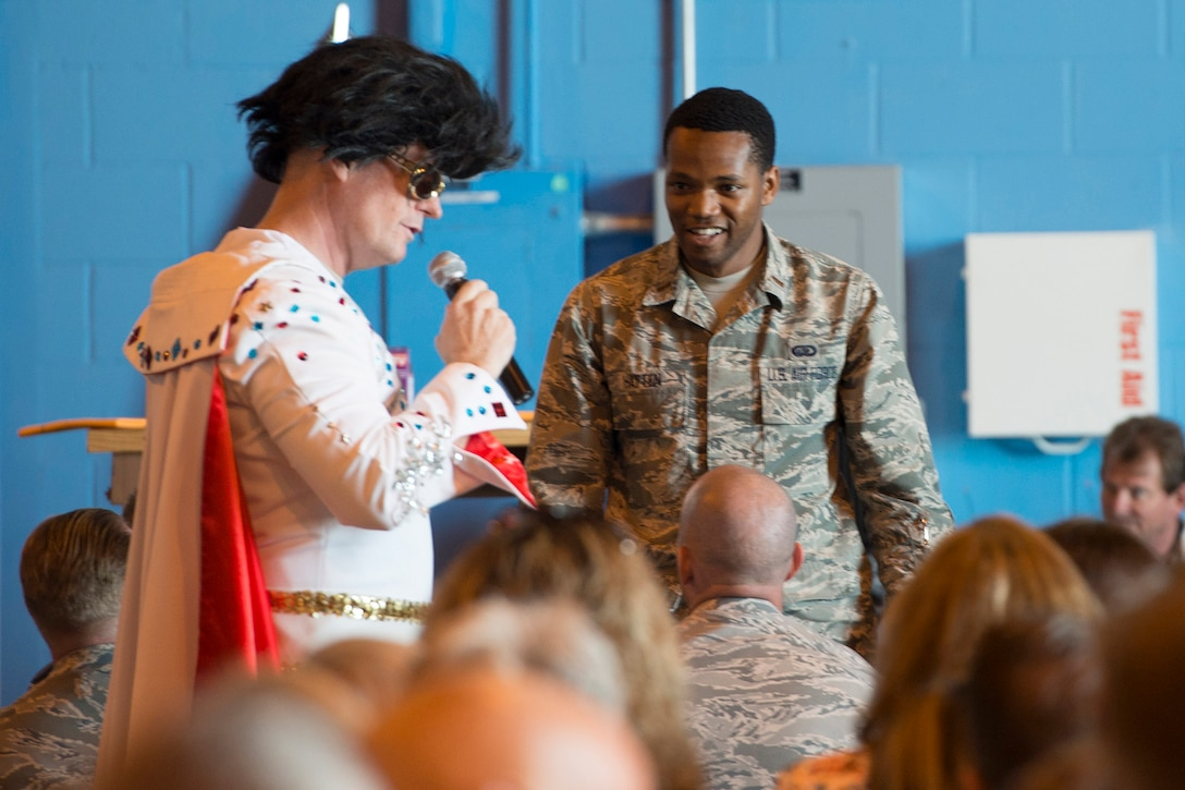 Personnel from the 45th Mission Support group participate in a game show themed trivia competition during their group's Commander's Call April 20, 2016 at Cape Canaveral Air Force Station. , Fla. The group's objective was to gather together in a location where the 45th Space Wing's launch operations happen to get up close and personal with the mission and history of the wing in an interactive, informative way. The 45th MSG's five squadrons provide total customer support for the world's busiest spaceport, assuring success of launch, range and expeditionary operations. Also, the 45th MSG Det. 1 is responsible for the day-to-day operations CCAFS. (U.S. Air Force photo by Matthew Jurgens/Released)
