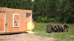 Marines with 2nd Combat Engineer Battalion detonate a charge while formed up in their stack during breaching operations at Marine Corps Base Camp Lejeune, North Carolina, May 19, 2016. The unit built, placed, and detonated charges to practice gaining entry and clearing an enemy-occupied building in preparation for an upcoming deployment.