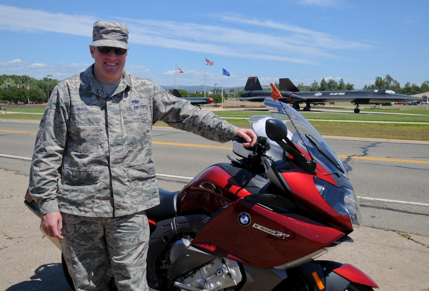 Tech. Sgt. Nicholas Ward, 9th Aircraft Maintenance Squadron assistant 1st Sgt., poses next to his motorcycle May 16, 2016, at Beale Air Force Base, California. (U.S. Air Force photo by Senior Airman Michael J. Hunsaker)