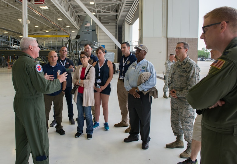 Maj. Shane Devlin, 53rd Weather Reconnaissance Squadron pilot, briefs employers from across the nation about the Hurricane Hunter mission and WC-130J Super Hercules aircraft used to collect weather data sent to the National Hurricane Center in Miami for use in their forecasts.The 403rd Wing hosted 15 employers of Air Force reservists from across the nation as part of the Air Force Reserve Command Employer Appreciation Day May 20, 2016. (U.S. Air Force photo/Marie Floyd)