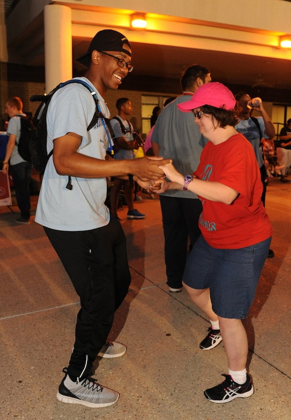 Airman Marcus Houston, 336th Training Squadron student, dances with Mary Wilson, Special Olympics athlete, at the Special Olympics Mississippi Summer Games closing ceremonies at the triangle area May 21, 2016, Keesler Air Force Base, Miss. This is the 30th year Keesler has hosted the state Special Olympics.  (U.S. Air Force photo by Kemberly Groue)