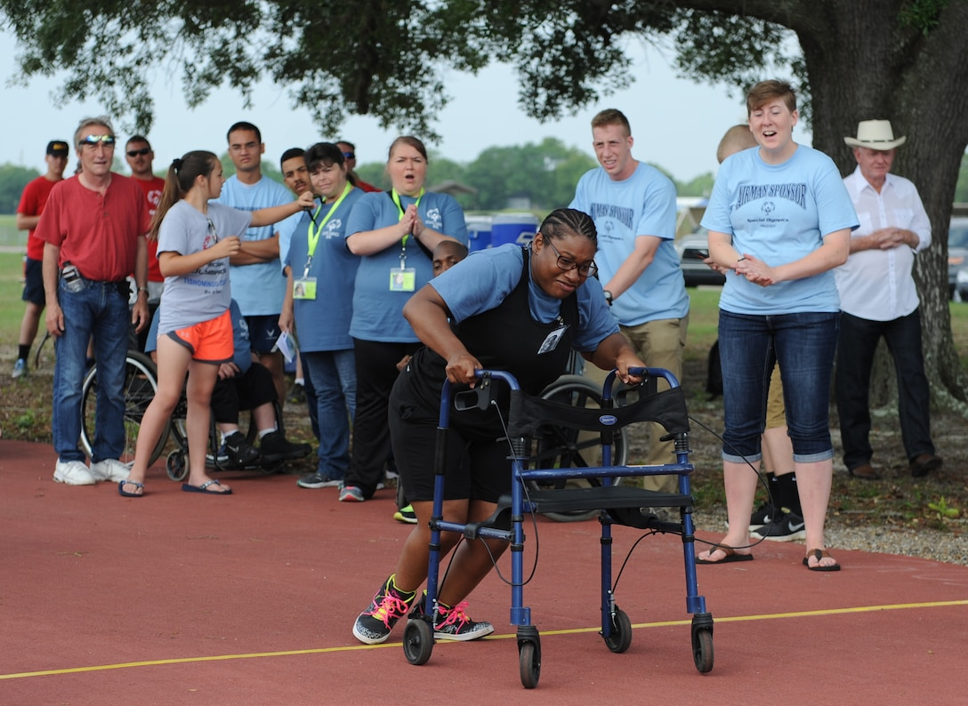 Calissa Spight, Special Olympics athlete, participates in the 25 meter assisted walk during the Special Olympics Mississippi Summer Games at the triangle track May 21, 2016, Keesler Air Force Base, Miss. More than 700 athletes and 3,000 volunteers worked together to hold competitions throughout the day. This is the 30th year Keesler has hosted the state Special Olympics.  (U.S. Air Force photo by Kemberly Groue)