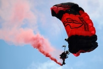 A member of the Black Daggers, the U.S. Army Special Operations Command's parachute demonstration team, performs an aerial maneuver during the Shaw Air Expo and open house at Shaw Air Force Base, S.C., May 21, 2016. Air Force photo by Airman 1st Class Kelsey Tucker