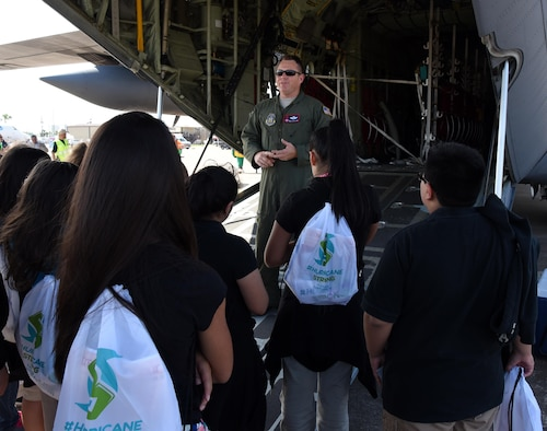 Senior Master Sgt. Jay Latham, 53rd Weather Reconnaissance Squadron dropsonde operator, briefs students during the Gulf Coast Hurricane Awareness Tour May 16-20, 2016. The Air Force Reserve Hurricane Hunter aircrew with their WC-130J Super Hercules, based out of Keesler Air Force Base, Mississippi, and a team of National Oceanic and Atmospheric Administration hurricane experts visited five Gulf Coast cities as part of this year's tour. (U.S. Air Force photo/Maj. Marnee A.C. Losurdo)