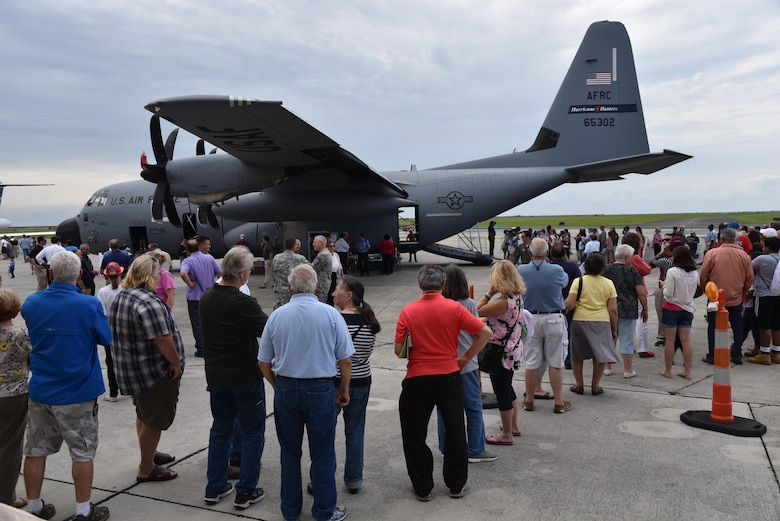 The New Orleans public lines up at the Lakefront Airport May 18, 2016, to tour the WC-130J Super Hercules Aircraft used by the 53rd Weather Reconnaissance Squadron to collect weather data for the National Hurricane Center used to improve their forecasts. An Air Force Reserve Hurricane Hunter aircrew and a team of National Oceanic and Atmospheric Administration hurricane experts visited five Gulf Coast cities as part of the Hurricane Awareness Tour May 16-20, 2016. The tour is a joint effort between NOAA's National Weather Service and National Hurricane Center and the 403rd Wing's 53rd Weather Reconnaissance Squadron to promote awareness about the destructive forces of hurricanes and how people can prepare. (U.S. Air Force photo/Maj. Marnee A.C. Losurdo)