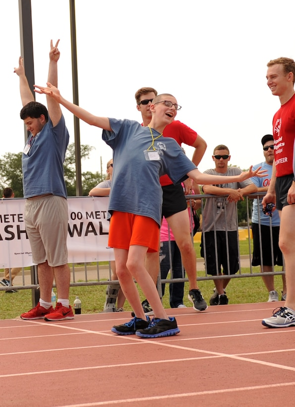 Athletes react to the announcement of their names at the track events during the Special Olympics Mississippi Summer Games at the triangle track May 21, 2016, Keesler Air Force Base, Miss. More than 700 athletes and 3,000 volunteers worked together to hold competitions throughout the day. This is the 30th year Keesler has hosted the state Special Olympics.  (U.S. Air Force photo by Kemberly Groue)