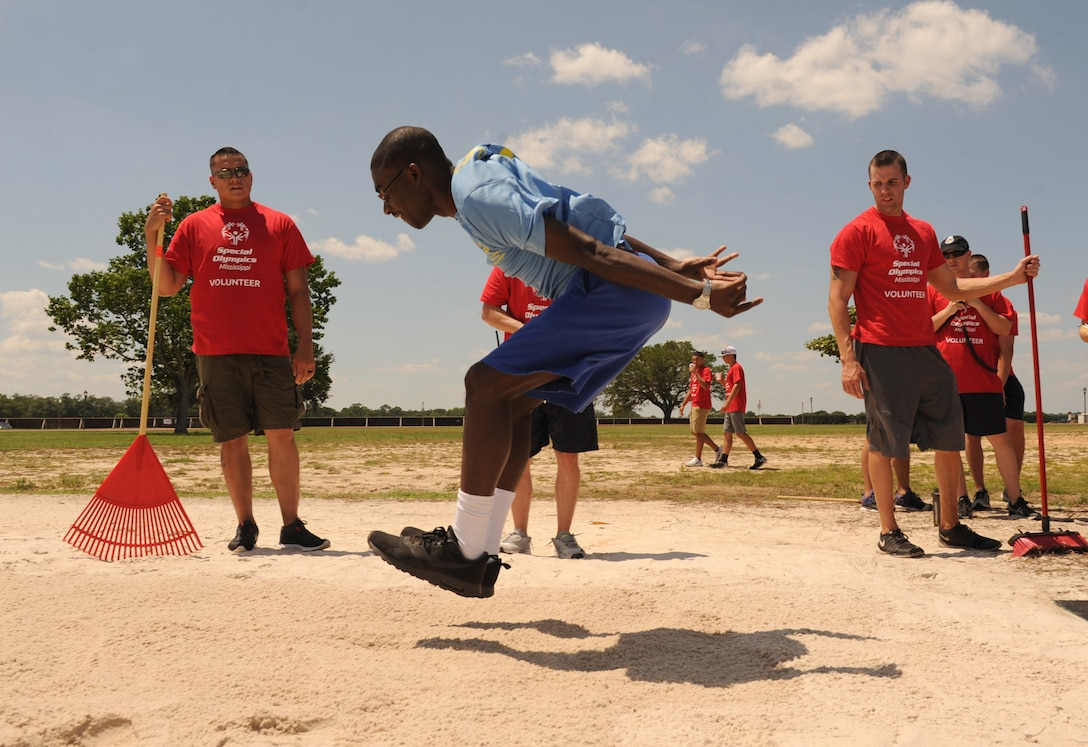 Mike Brown, Special Olympics athlete, participates in the standing long jump competition during the Special Olympics Mississippi Summer Games at the triangle track May 21, 2016, Keesler Air Force Base, Miss. More than 700 athletes and 3,000 volunteers worked together to hold competitions throughout the day. This is the 30th year Keesler has hosted the state Special Olympics.  (U.S. Air Force photo by Kemberly Groue)