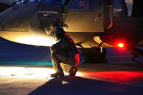 Defense Logistics Agency Aviation's Customer Operations Directorate in Richmond, Virginia is part of a team keeping the UH-60 platforms mission ready. The LED  (light-emitting diode) lights on the M model aircraft were replaced with previously used incandescent lights because of a halo and glare problem when using night vision equipment. Shown here the Puerto Rico National Guard Aviation prepares to conduct night flight training aboard UH-60 Black Hawk helicopters, with the assistance of helmet-mounted AN/AVS-6 vision goggles, at the Aviation Support Facility in Isla Grande, Sept. 2, 2014.