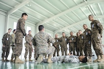 160523-N-WI365-040 ULAANBAATAR, Mongolia (May 23, 2016) - Fleet Marine Force (FMF) Hospital Corpsman 2nd Class Joshua Rogers, assigned to the 3rd Medical Battalion explains the proper use of a tourniquet to members of the Mongolian Armed Forces during a casualty control familiarization class as part of Khaan Quest 2016. Khaan Quest 2016 is an annual, multinational peacekeeping operations exercise hosted by the Mongolian Armed Forces, co-sponsored by U.S. Pacific Command, and supported by U.S. Army Pacific and U.S. Marine Corps Forces, Pacific. Khaan Quest, in its 14th iteration, is the capstone exercise for this year's Global Peace Operations Initiative program. The exercise focuses on training activities to enhance international interoperability, develop peacekeeping capabilities, build to mil-to-mil relationships, and enhance military readiness. (U.S. Navy photo by Mass Communication  Specialist 3rd Class Markus Castaneda/RELEASED)