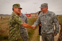 U.S. Navy Adm. Harry B. Harris, commander, U.S. Pacific Command, greets U.S. Army Col. Jeffrey Roach, commander, 38th Troop Command, before the Khaan Quest 2016 opening ceremony at the Five Hills Training Area, Mongolia, May 22, 2016. Khaan Quest is an annual, multinational peacekeeping operations exercise conducted in Mongolia and is the capstone exercise for this year's United Nations Global Peace Operations Initiative program.