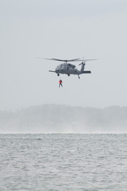 The 301st Rescue Squadron, of the 920th Rescue Wing, use their HH-60 Pave Hawk to hoist aircrew from the 445th Airlift Wing, Wright-Patterson AFB, Ohio, during a water survival training course held at Patrick AFB, Fla., May 17, 2016. Trainees simulated needing rescue from the Banana River. The 920th RQW is an Air Force Reserve Command combat-search-and-rescue unit. (U.S. Air Force photos/Benjamin Thacker/Released)