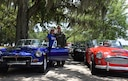 Lt. Col. Jeff Ragusa, 53rd Weather Reconnaissance Squadron pilot, and his wife Susan, are members of the British Car Club of New Orleans. They own a 1974 MGB Roadster that Ragusa bought and drove  as a college student years ago. The car club commemorated the Post World War II use of U.S. Air Force runways for auto racing by driving down the Keesler Air Force Base, Mississippi, runway May 21, 2016. In the Post-WWII era of early U.S. auto racing, there were several tragedies due to people racing on roadways. This mandated the move from road racing to tracks. However, before the tracks were ready, Gen. Curtis LeMay, a sports car enthusiast, allowed the use of U.S. Air Force runways at Strategic Air Command bases to the Sports Car Club of America for racing. The first two SCCA champions in 1951 and 1952 drove British sports cars. (U.S. Air Force/Maj. Marnee A.C. Losurdo)