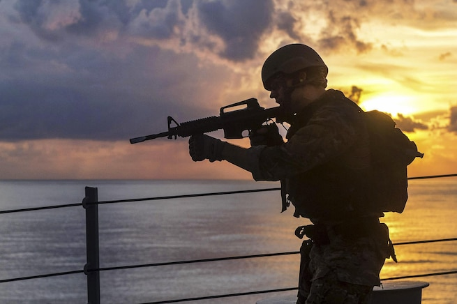 A sailor trains aboard the USS William P. Lawrence in the South China Sea, May 17, 2016. The guided-missile destroyer is on a regularly scheduled 7th Fleet deployment. The sailor is assigned to the assigned to the visit, board, search and seizure team. Navy photo by Petty Officer 3rd Class Emiline L. M. Senn