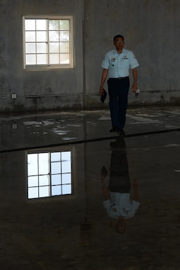 Philippine air force Staff Sgt. Generex Sazon, Air Force Chief of Engineers Office NCO in charge, tours a warehouse under construction at the Pacific Regional Training Center during a Pacific Unity event May 10, 2016, at Andersen Air Force Base, Guam. The Pacific Unity 16-1 tilt-up workshop is a Pacific Air Forces-led engagement focusing on a series of civil engineering subject-matter expert exchanges designed to increase partner capabilities, military relations and regional stability for the Indo-Asia-Pacific region. (U.S. Air Force photo by Airman 1st Class Jacob Skovo)