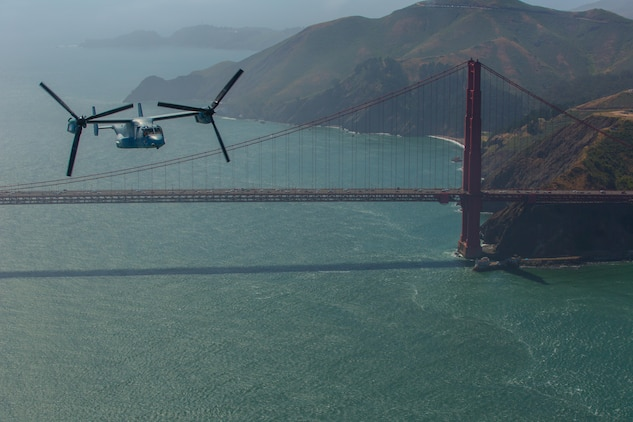 """Marines with Marine Medium Tiltrotor Squadron (VMM) 161 """"Greyhawks,"""" fly over the Golden Gate Bridge in San Francisco, May 19. Lt. Col. Andreas Lavato, commanding officer of VMM-161, conducted his last flight with the squadron prior to his change of command on May 26. (U.S. Marine Corps photo by Sgt. Lillian Stephens/Released)"""