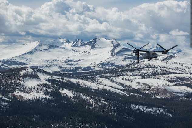 """Marines with Marine Medium Tiltrotor Squadron (VMM) 161 """"Greyhawks,"""" fly over Yosemite National Forest, Calif., May 19. Lt. Col. Andreas Lavato, commanding officer of VMM-161, conducted his last flight with the squadron prior to his change of command May 26. (U.S. Marine Corps photo by Sgt. Lillian Stephens/Released)"""
