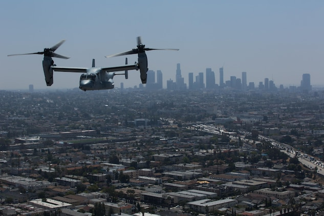 """Marines with Marine Medium Tiltrotor Squadron (VMM) 161 """"Greyhawks,"""" fly over Los Angeles, May 19. Lt. Col. Andreas Lavato, commanding officer of VMM-161, conducted his last flight with the squadron prior to his change of command May 26. (U.S. Marine Corps photo by Sgt. Lillian Stephens/Released)"""