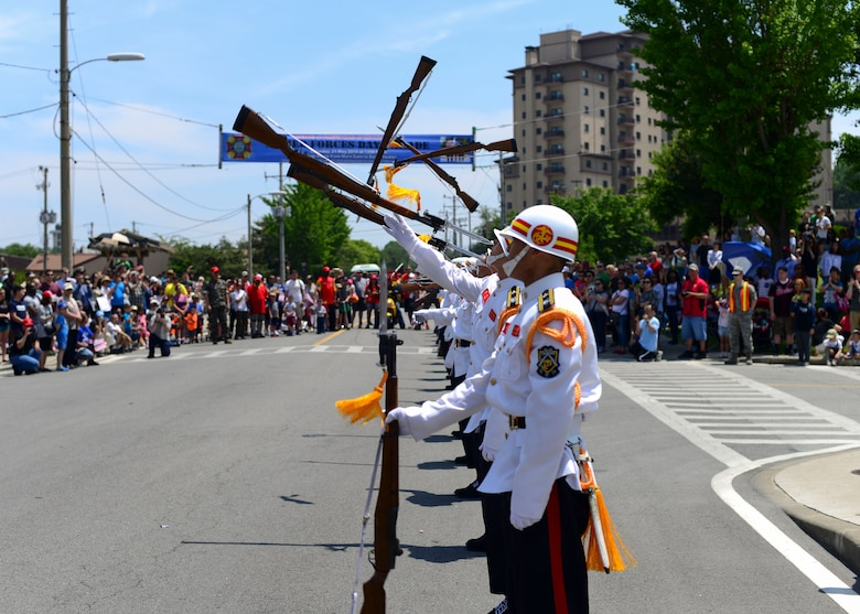Members of the Republic of Korea marine corps drill team perform a rifle movement during a demonstration at the end of the Armed Forces Day Parade at Osan Air Base, Republic of Korea, May 21, 2016. The demonstration was the grand finale of the parade, which was hosted by the local Veterans of Foreign Wars, Post 10216. (U.S. Air Force photo by Senior Airman Victor J. Caputo/Released)