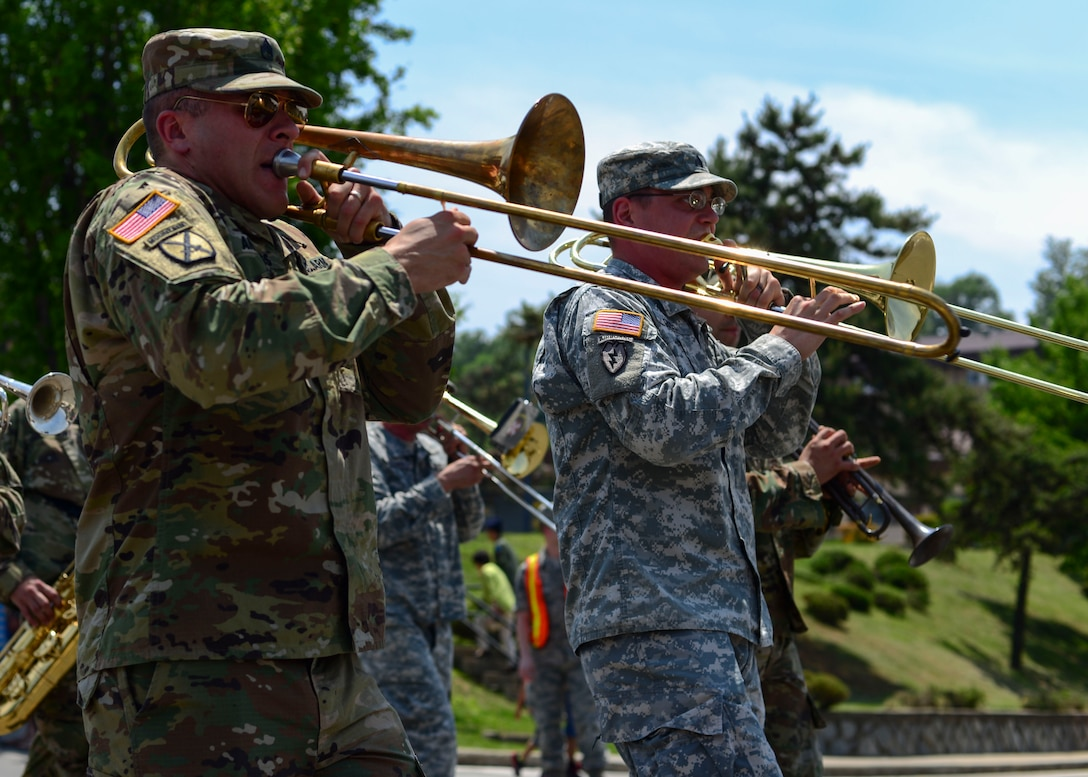 Soldiers assigned to the 8th Army Band perform during the Armed Forces Day Parade at Osan Air Base, Republic of Korea, May 21, 2016. The band was one of the many participants in the parade, which was hosted by the local Veterans of Foreign Wars, Post 10216. (U.S. Air Force photo by Senior Airman Victor J. Caputo/Released)