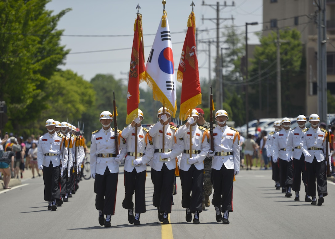 Members of the Republic of Korea marine corps drill team march in the Armed Forces Day Parade at Osan Air Base, Republic of Korea, May 21, 2016. The drill team held a demonstration at the end of the parade and performed alongside their accompanying band. (U.S. Air Force photo by Senior Airman Victor J. Caputo/Released)