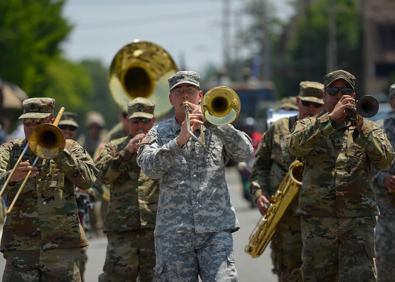 Soldiers assigned to the 8th Army Band participate in the Armed Forces Day Parade at Osan Air Base, Republic of Korea, May 21, 2016. The Veterans of Foreign Wars, Post 10216 in Songtan hosted the parade, which drew crowds of families and onlookers from all of Team Osan. (U.S. Air Force photo by Senior Airman Victor J. Caputo/Released)