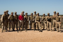 Ray Mabus, Secretary of the Navy, and Marines with the Scout Sniper Platoon smile for a group photo at Mount Bundey Training Area, Northern Territory, Australia, May 14, 2016. He came to Australia to visit the Marines and Sailors of Marine Rotational Force – Darwin and observe live-fire ranges. The Marines are with 1st Battalion, 1st Marine Regiment, MRF-D.