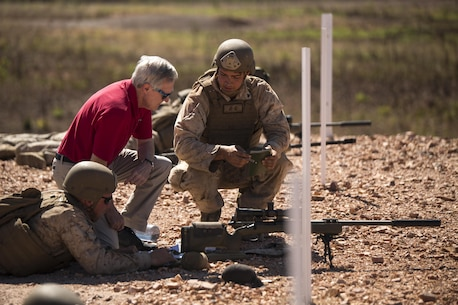 Cpl. Chance A. Benedict Jr., a mortarman, talks to Ray Mabus, Secretary of the Navy, about the M40A5 sniper rifle at Mount Bundey Training Area, Northern Territory, Australia, May 14, 2016. Mabus came to Australia to visit the Marines and Sailors of Marine Rotational Force – Darwin and observe live-fire ranges. Benedict is with 1st Battalion, 1st Marine Regiment, MRF-D.