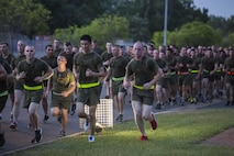 U.S. Marines with 1st Battalion, 1st Marine Regiment, run in formation on Robertson Barracks, Darwin, Australia, April 29, 2016. Running together helps Marines acclimatize to the hot and humid Australian environment during Marine Rotational Force - Darwin (MRF-D). MRF-D is a six-month deployment of Marines into Darwin, Australia, where they will conduct exercises and train with the Australian Defence Forces, strengthening the U.S.-Australia alliance.