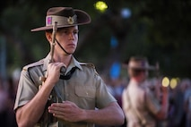 Members of the Australian Defence Forces, civilians and U.S. Marines with 1st Battalion, 1st Marine Regiment celebrate Australian New Zealand Army Corps (ANZAC) Day during a dawn service in Palmerston, Australia on April 25, 2016. Marine Rotational Force Darwin (MRF-D) is a six-month deployment of Marines into Darwin, Australia, where they will conduct exercises and train with the Australian Defence Forces, strengthening the U.S.-Australia alliance.