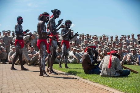U.S. Marines with 1st Battalion, 1st Marine Regiment, watch a traditional Aboriginal dance during the Welcome to Country Ceremony on Robertson Barracks, Darwin, Australia on April 22, 2016. Marine Rotational Force Darwin (MRF-D) is a six-month deployment of Marines into Darwin, Australia, where they will conduct exercises and train with the Australian Defence Forces, strengthening the U.S.-Australia alliance.