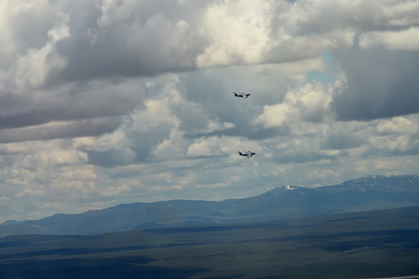 Two McChord C-17 Globemaster IIIs fly over the Mountain Home Range Complex, Idaho, May 17, 2016. The McChord tails were two of seven C-17s working with F-15 Strike Eagles C-17s in training as part of a Large Force Exercise at the Mountain Home Range Complex in preparation for Air Mobility Command's next generation exercise Mobility Guardian. (U.S. Air Force photo/Staff Sgt. Naomi Shipley)