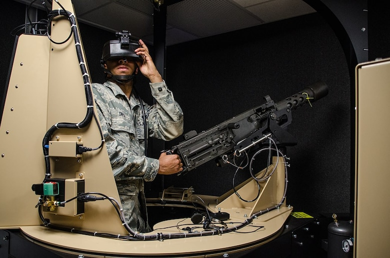 Senior Airman Westley Smith, a weapons loader with the 131st Bomb Wing, participates in a virtual-reality gunner station during Annual Training at Camp Clark, Missouri, on May 18, 2016. The simulation is part of the Virtual Clearance Training Suite that helps train Airmen on real-life scenarios.