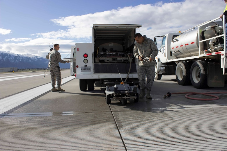 Capt. Andrew Jouben, chief of the Air Force Civil Engineer Center Airfield Pavement Evaluation, or APE, Team and Master Sgt. Robinson Hidalgo, superintendent of the AFCEC APE Team, wrap up a friction test on the runway at Hill AFB, Utah.