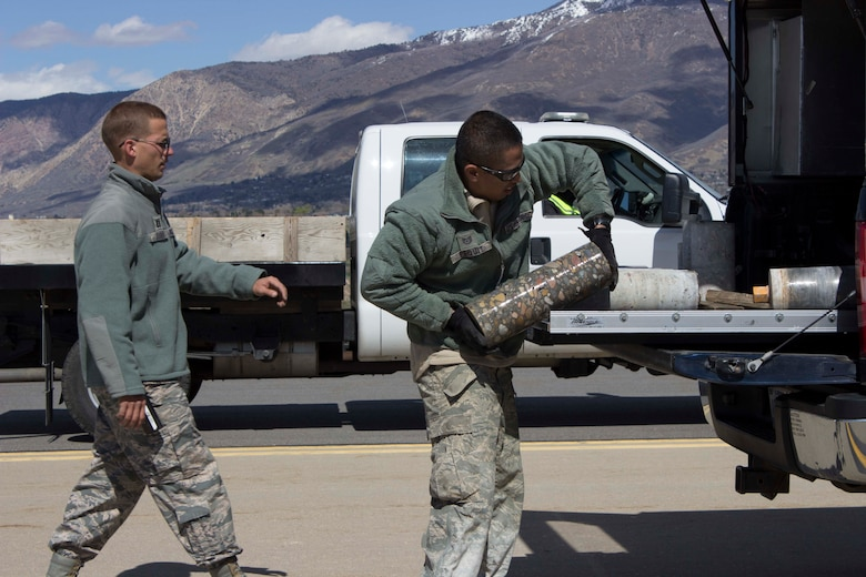Capt. Andrew Jouben, chief of the Air Force Civil Engineer Center Airfield Pavement Evaluation, or APE, Team, and Tech. Sgt. Allin Pequit, APE Team technician, collect core samples taken from Hill AFB, Utah, during a recent airfield pavement evaluation.