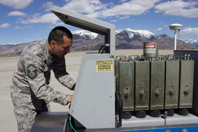 Master Sgt. Robinson Hidalgo, superintendent of the Air Force Civil Engineer Center Airfield Pavement Evaluation, or APE, Team, prepares the heavy weight deflectometer to test airfield pavement at Hill AFB, Utah.