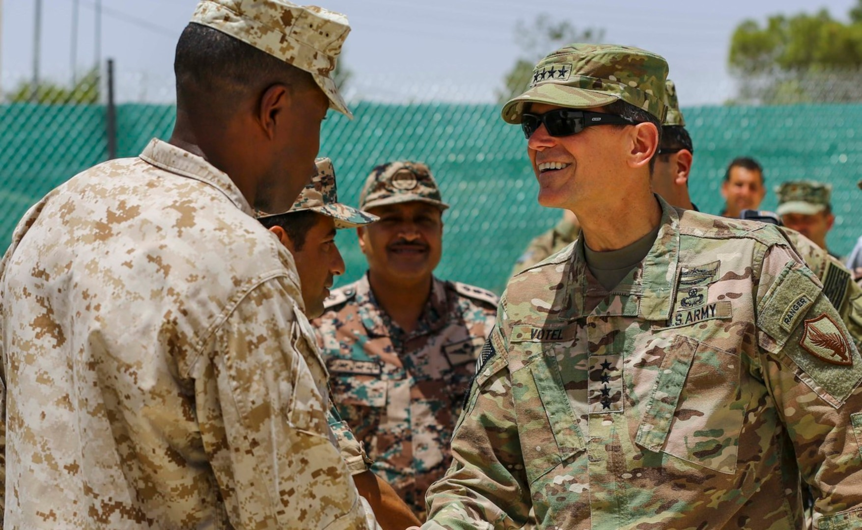 U.S. Army Gen. Joseph Votel Commander of U.S. Central Command, meets with U.S. Marine Sgt. Maj. Clifford Wiggins, 5th Marine Expeditionary Brigade, and members of the Jordanian Armed Forces during Exercise Eager Lion 16 near Amman, Jordan on May 22, 2016.