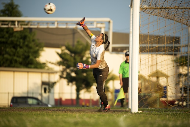 Sarah Cronin, goalkeeper and center midfielder from the Panthers girls' soccer team from Yokota High School, blocks a shot at the goal during the last part of the championship game in the Far East Soccer Tournament hosted by Matthew C. Perry High School at Marine Corps Air Station Iwakuni, Japan, May 19, 2016. The Far East Soccer Tournament is the largest soccer event that Department of Defense Education Activity Schools Pacific in Japan, Korea and International Schools have to look forward to compete in all season. (U.S. Marine Corps photo by Lance Cpl. Donato Maffin/Released)